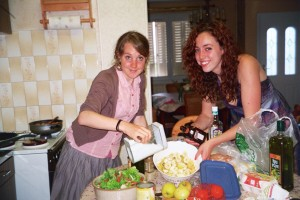 My host sister, Kitty, and I cook vegetables in Annick's kitchen.