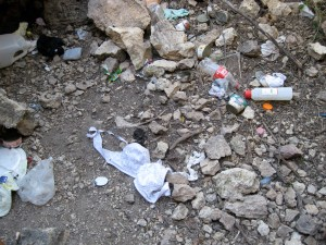 Human debris left by migrants on the trail.