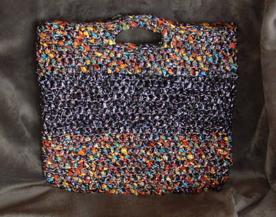A Tote Bag Made From VCR Tapes and Ribbon Yarn